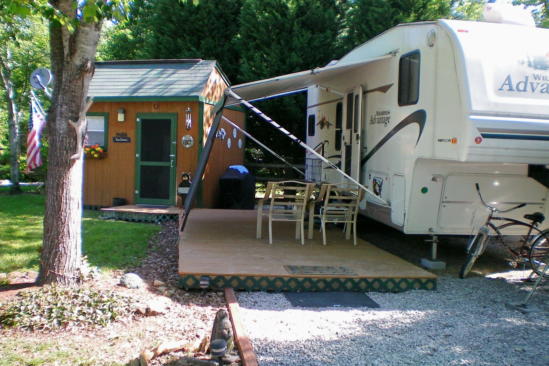 Rv decks rv lot with stream at rear of property has for Rv shed ideas