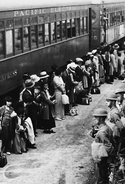 Americans of Japanese ancestry await relocation to internment camps further inland. Arcadia, California, 1942.