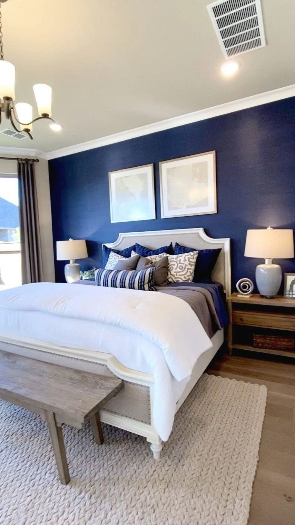 master bedroom design with royal blue accent wall behind