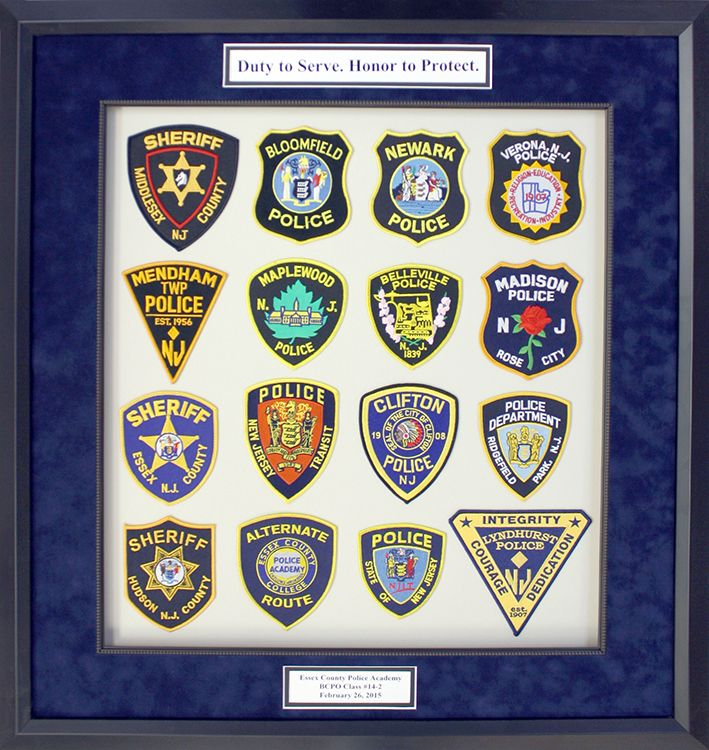 Police badges framed with deep blue suede mat board, classic black ...