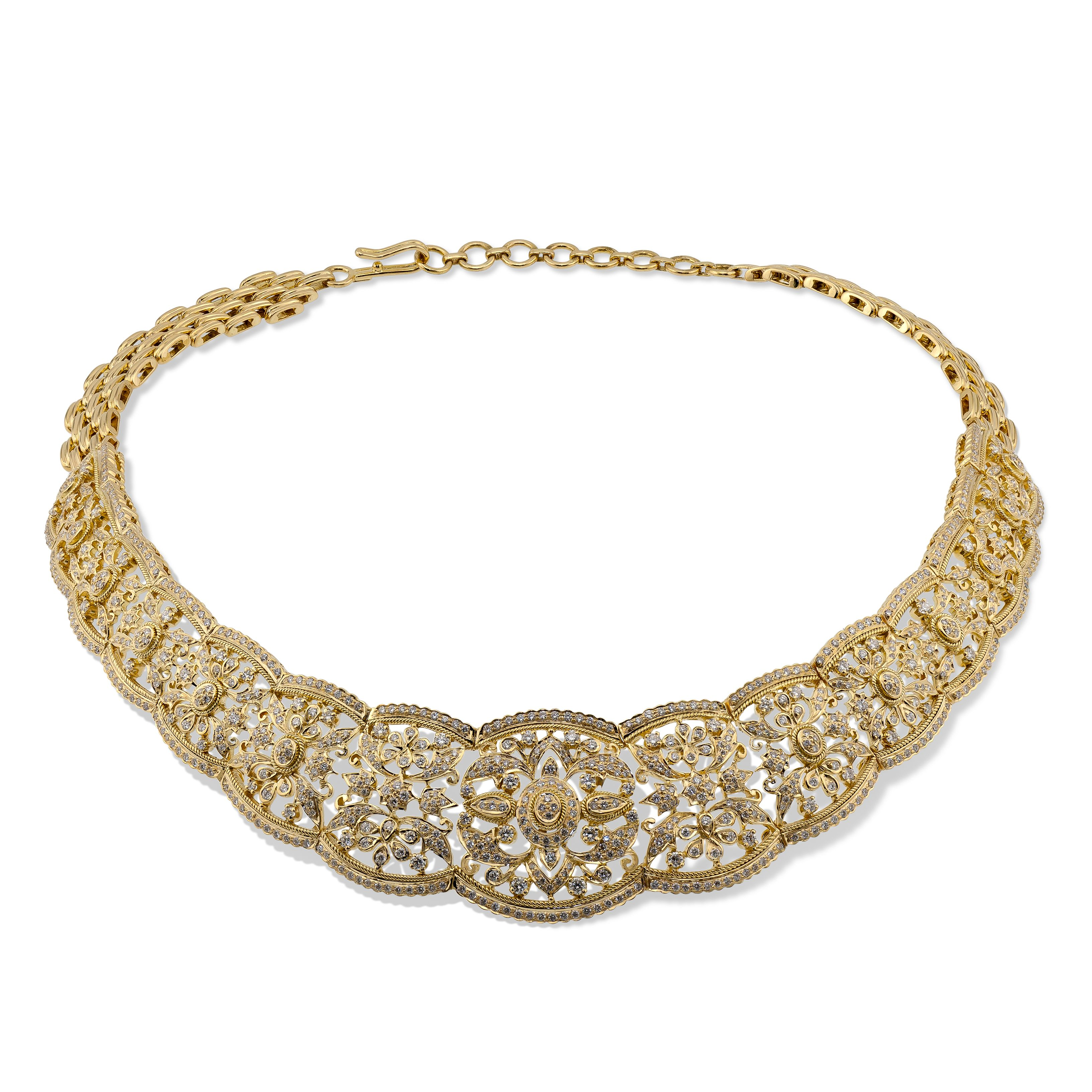 Like a bride's delicate veil on her wedding day, a mesmerizing net of floral craftsmanship steals your breath away in this beautiful necklace. Browse Devam bridal creations online.