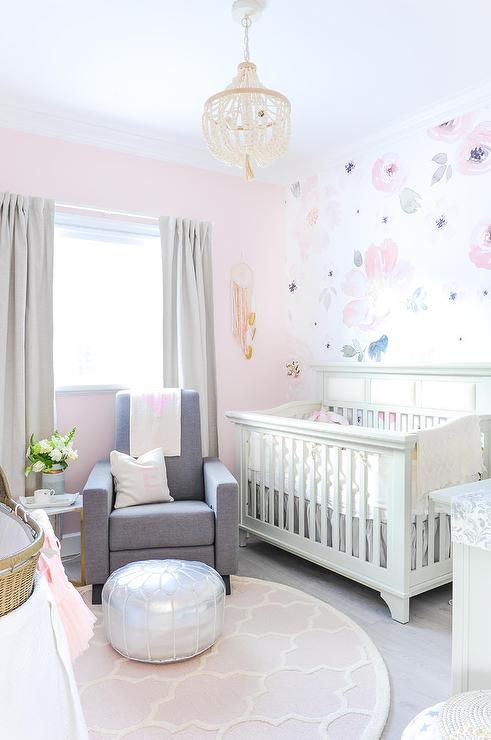 A Cream Beaded Chandelier Hangs Over Round Pink Trellis Rug Ad Illuminates Gorgeous Ivory And Nursery Boasting Charcoal Gray Glider Topped With