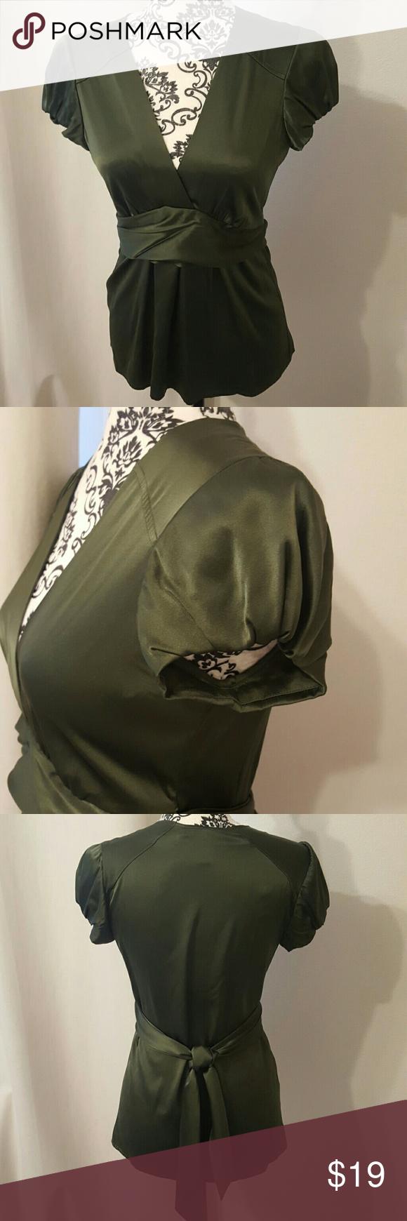 BCBG Silk blouse 93% silk. 7% spandex. Ties in the back. BCBGMaxAzria Tops Blouses