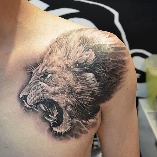 Heart of a lion done by Elvin Tattoo, Singapore. Lion