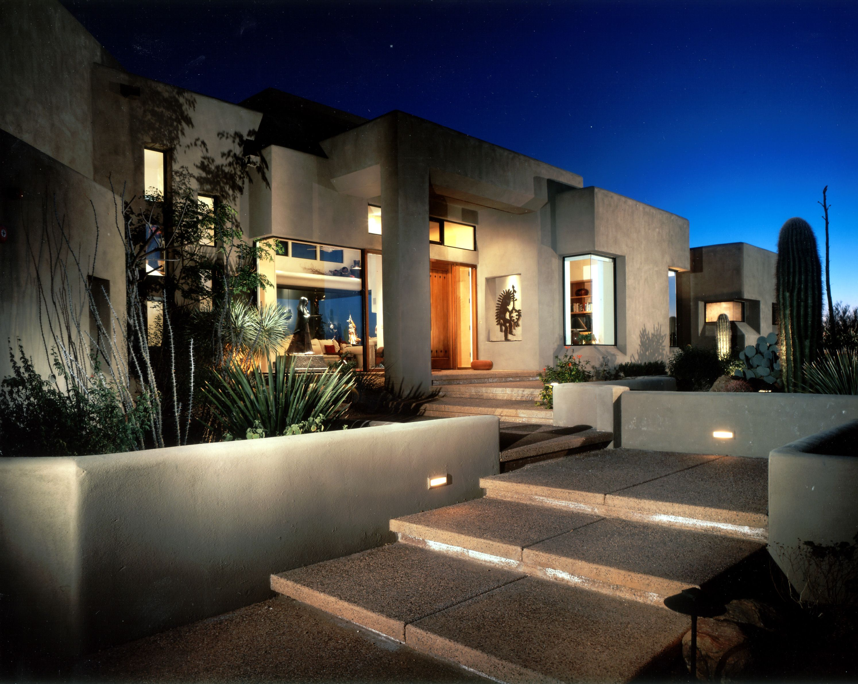 Outdoor Night Lighting Really Adds Drama To Our Design In Desert Mountain Scottsdale Green Wall Design Residential Design Overhead Hanging Lights