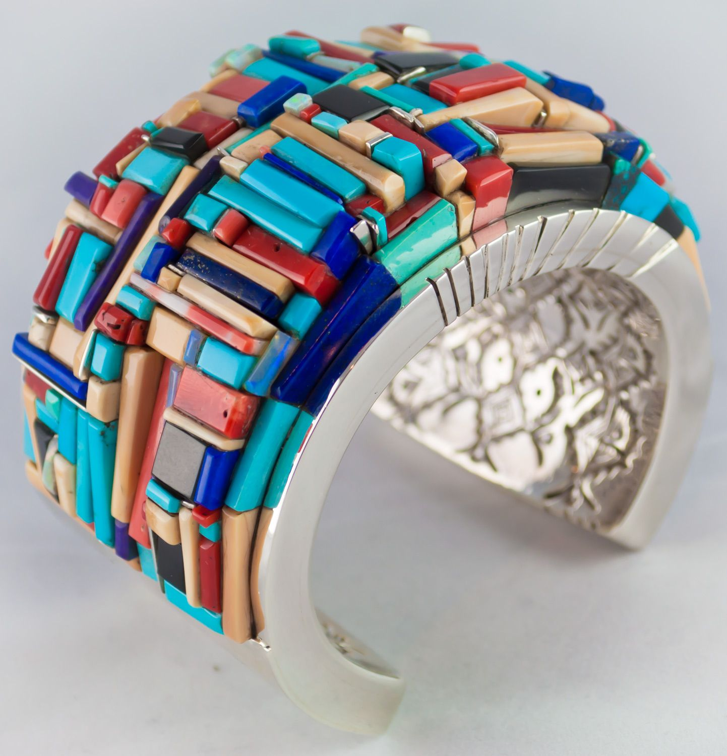 Pueblo Bracelet with turquoise, coral, opal, pink coral, walrus tusk, lapis, black jade, and chariote by Ken Romero