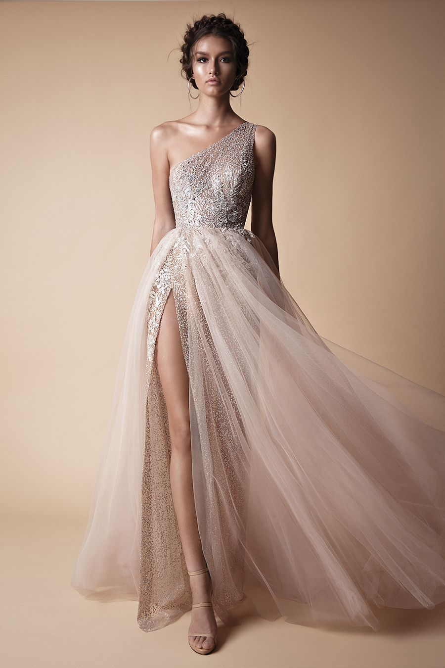 A gorgeous sexy one shoulder light rose coloured wedding gown with