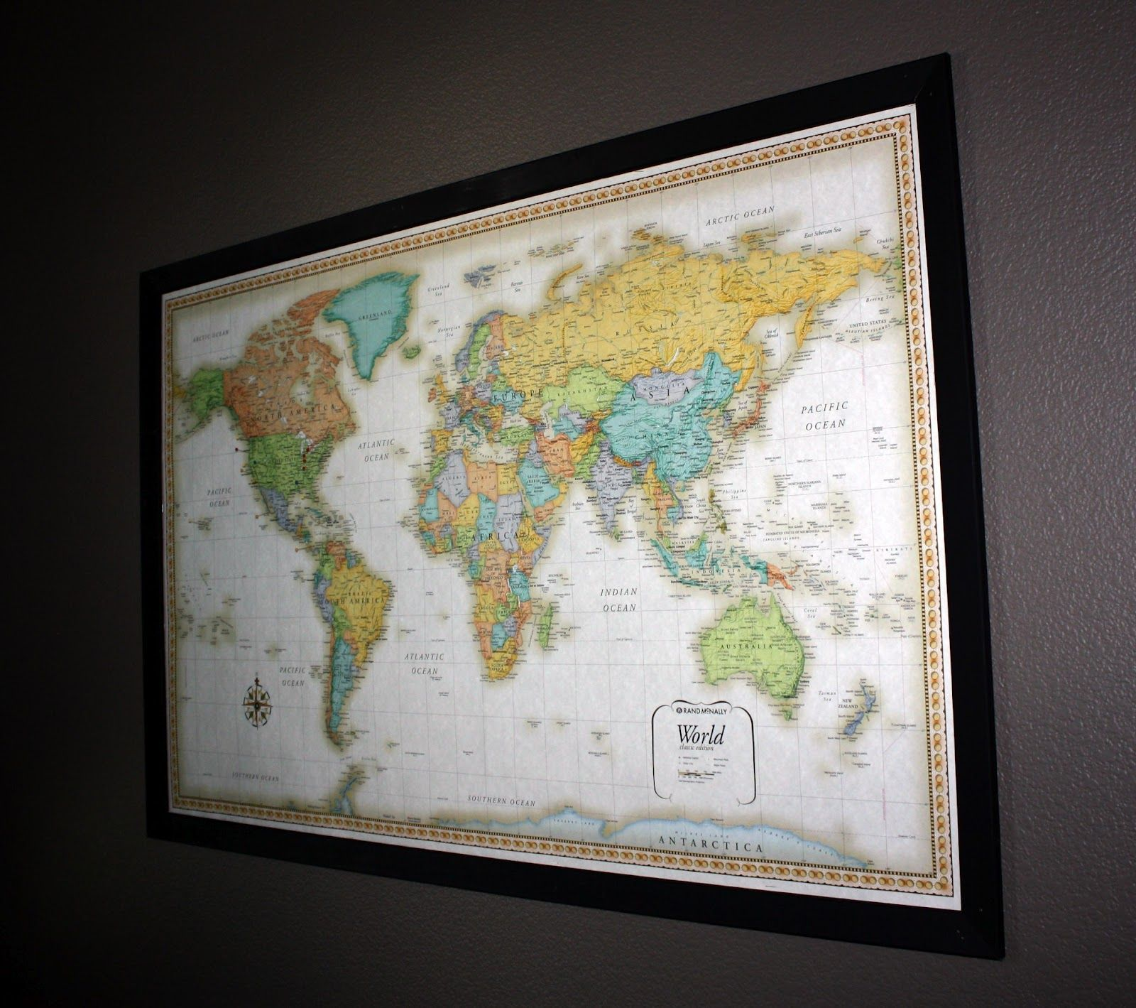 here 39 s another one dark frame around colored world map dwell diy frame framed maps map art. Black Bedroom Furniture Sets. Home Design Ideas
