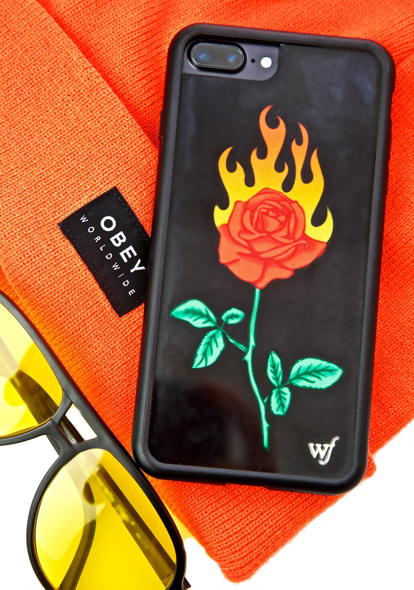 Wildflower Burning Love iPhone Case ...and it's gettin' hotter by the second, bb! This phone case features a black construction that fits snugly around yer phone and has a flaming rose on the back.