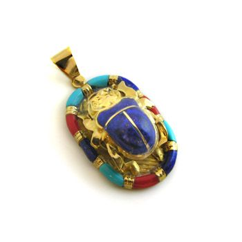 most unique gold scarab pendant with blue stone and attractive colored Enamel frame surrounding the scarab. The pendant made in Cairo