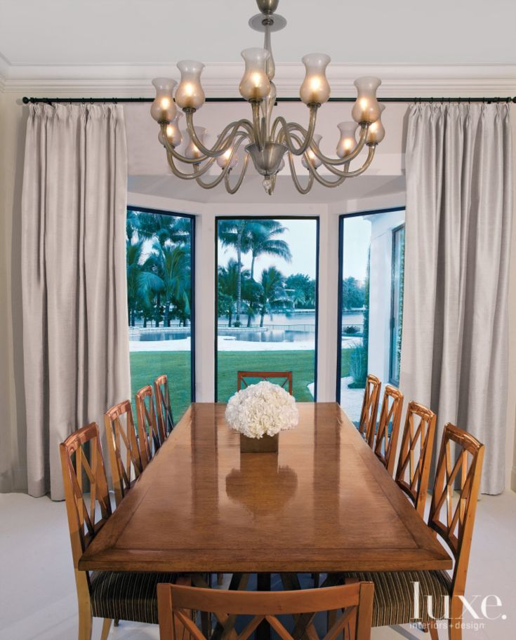 Contemporary White Dining Room With Bay Window