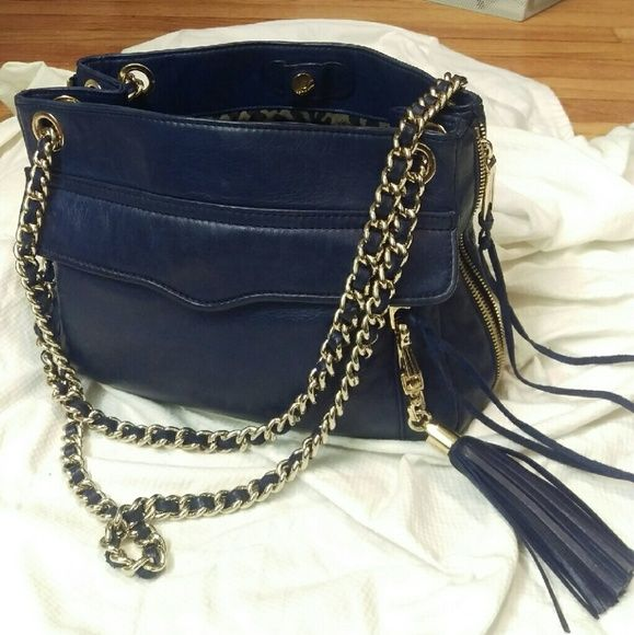 Rebecca minkoff Navy blue lamb skin purse. 🅿🅿 Leather and gold shoulder strap. Can be worn as cross body or double shoulder strap. Leather and gold tassel accent. Also has gold feet on bottom.  Very roomy inside .  Dimensions 11.5inch wide x 7.5inch high x 3.5inch  Selling only.   All Offers welcomed and 🅿🅿 Rebecca Minkoff Bags Shoulder Bags