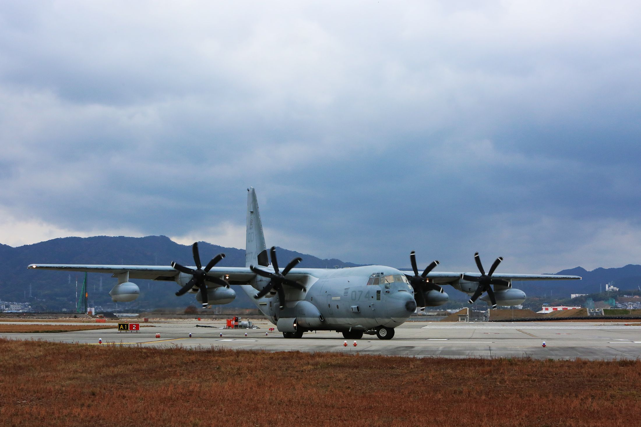 """MARINE CORPS AIR STATION IWAKUNI, Japan - A KC-130J Super Hercules with Marine Aerial Refueler Transport Squadron 152 taxies to the runway aboard Marine Corps Air Station Iwakuni, Japan, Dec. 1, 2014. The squadron, nicknamed """"Sumos"""", received the Chief of Naval Operations Aviation Safety Award for 2013 due to amassing more than 7,700 mishap-free flight hours last year."""