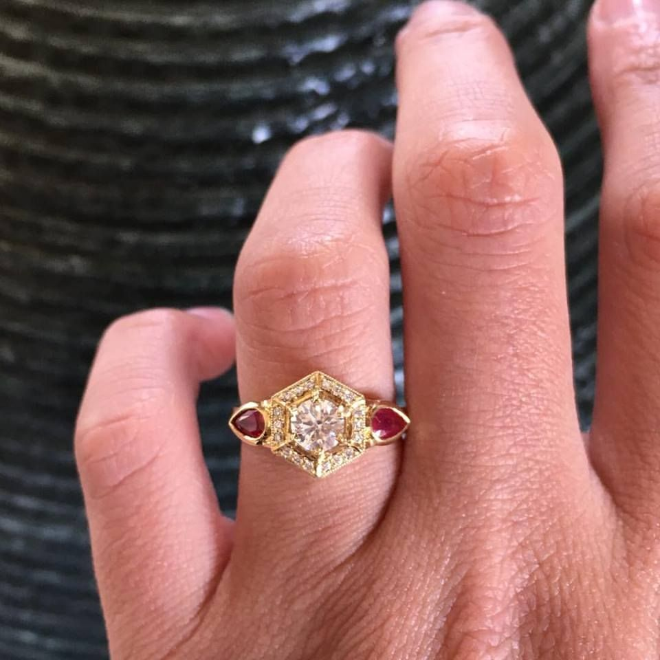 We think this 18 karat yellow gold diamond and ruby engagement ring ...