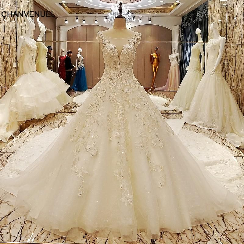 LS70985 elegant bridal gowns cape sleeves ball gown flower wedding gowns  with long tail robe de mariage 2017 real photos bf8e4f185909
