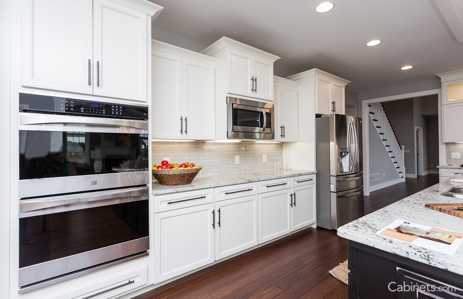 Add Dimension To Your Kitchen With These Stunning Staggered Cabinets Staggered Kitchen Cabinets Microwave Wall Cabinet Online Kitchen Cabinets