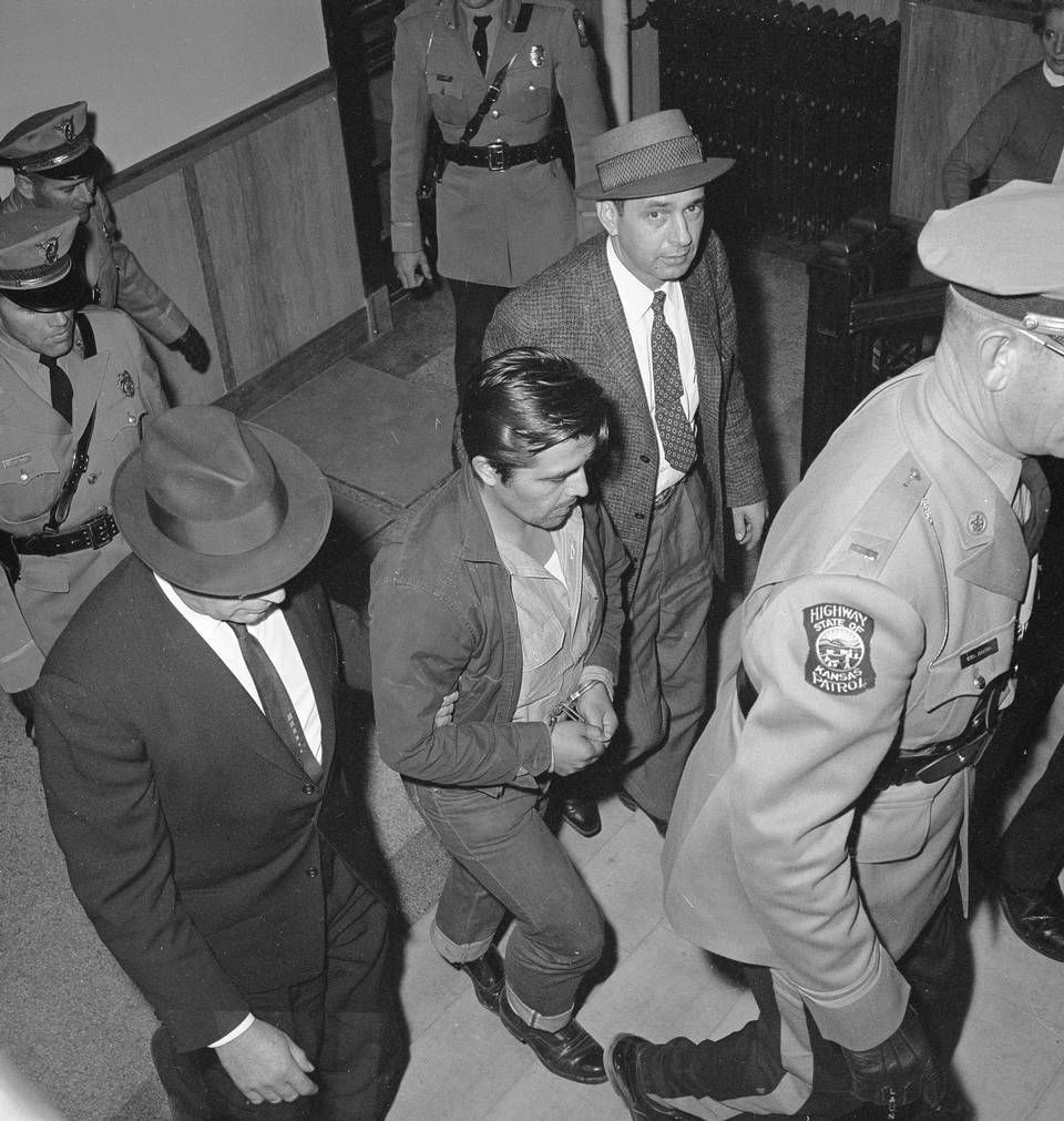 Perry Edward Smith is led by police officers into the courthouse at ...