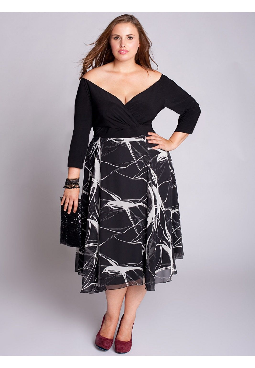 236056722e3 The plus size Kelly Dress from Igigi is perfect for dinner during the  holiday season. Its high waist and flared skirt oozes Old Hollywood  glamour