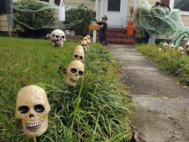 It seems as if every neighborhood has one or two: The local resident who doesn't just set out a jack-o-lantern or an inflatable ghost.