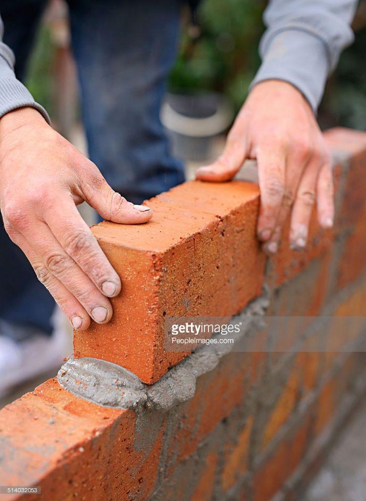Shot Of A Master Bricklayer At Work Mix Concrete Mortar Concrete Block Walls