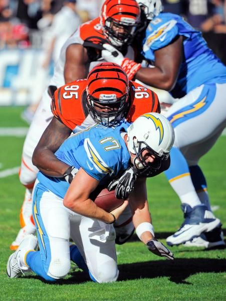 San Diego Chargers quarterback Philip Rivers (17) is sacked by Cincinnati Bengals defensive end Wallace Gilberry (95). (Denis Poroy/AP)