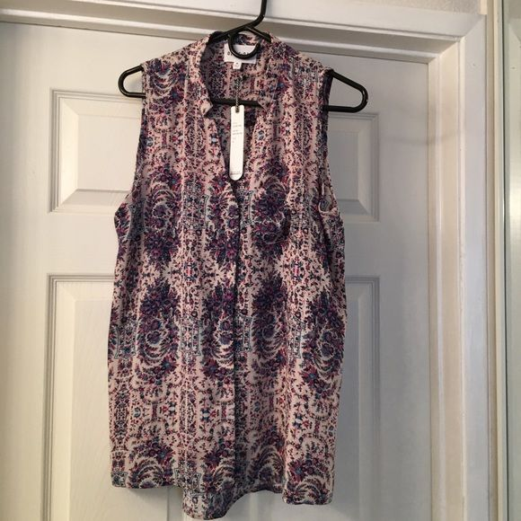 Olive + Oak  Sleeveless Top - Medium Beautiful Boho Flora Print color.  Style Lv5F60755BR, two button with decorative small pocket on left side and long at the back.     100% Polyester and hand wash only.  Very cute top. Olivia + Oak Tops Blouses