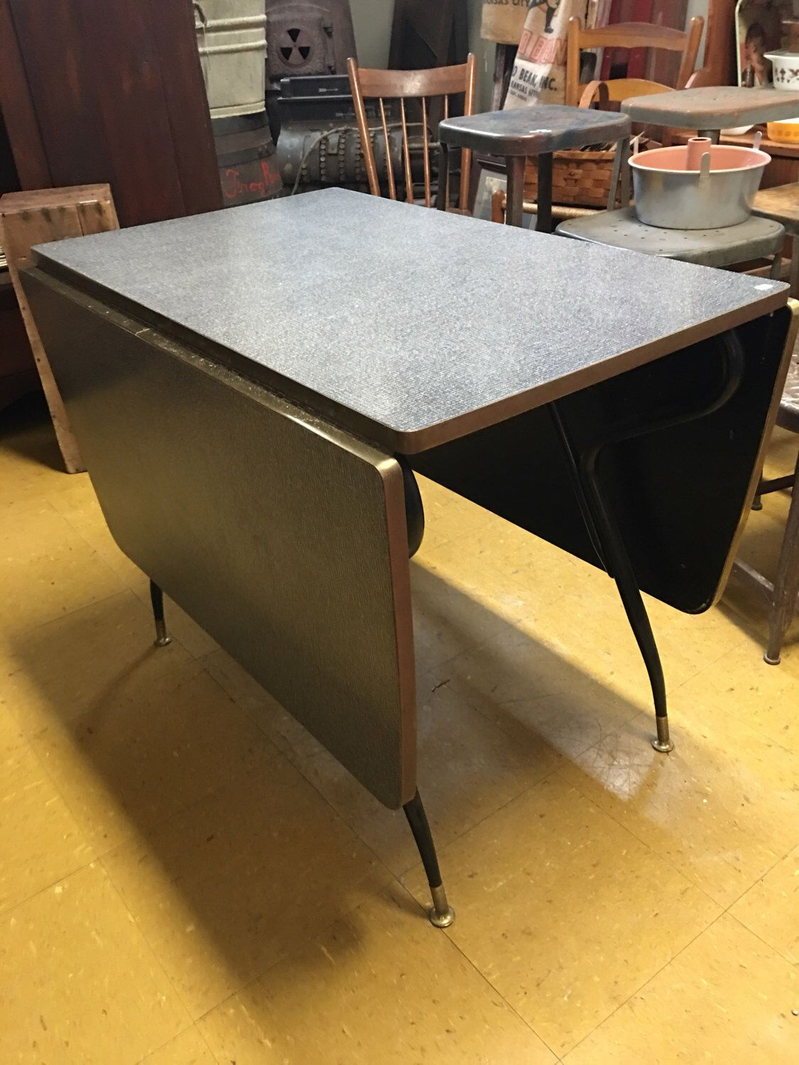 A personal favorite from my Etsy shop https://www.etsy.com/listing/512365375/mid-century-gray-formica-drop-leaf