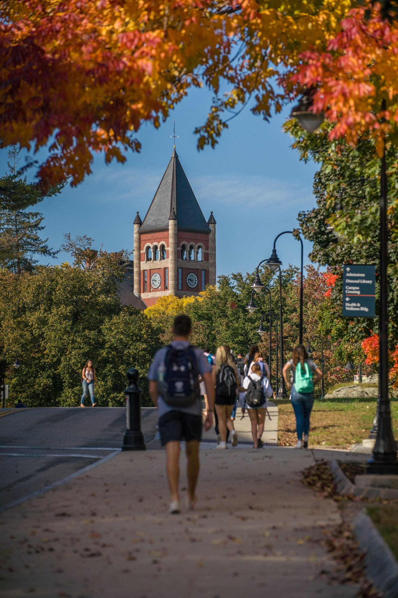 Unh Students Walk Towards T Hall On A Beautiful Fall Day At Peak