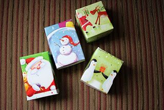 Repurpose your old holiday cards into small gift boxes...tutorial