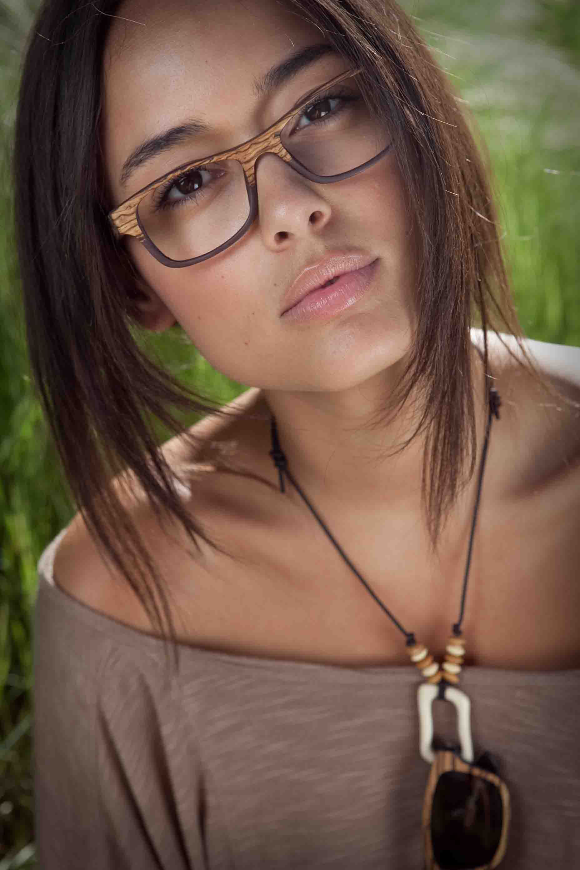 c9cd8d2664 Beautiful Chelsea Gilligan wearing wooden glasses by Sire s Crown. Hiroki  frame in Olive Ash Burl wood