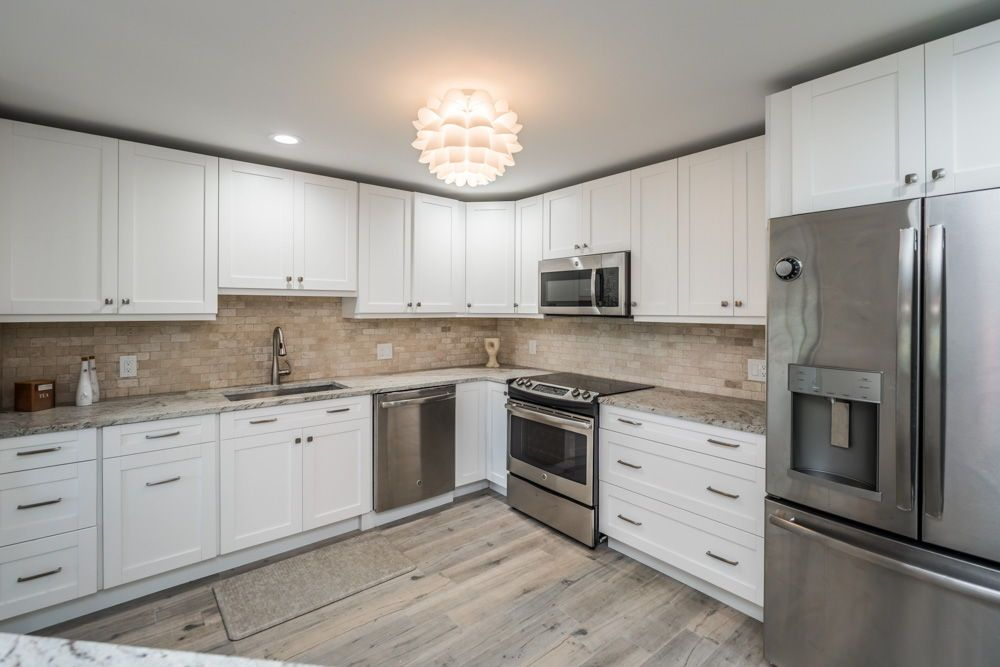 The fully updated kitchen includes a 2017 renovation with ...