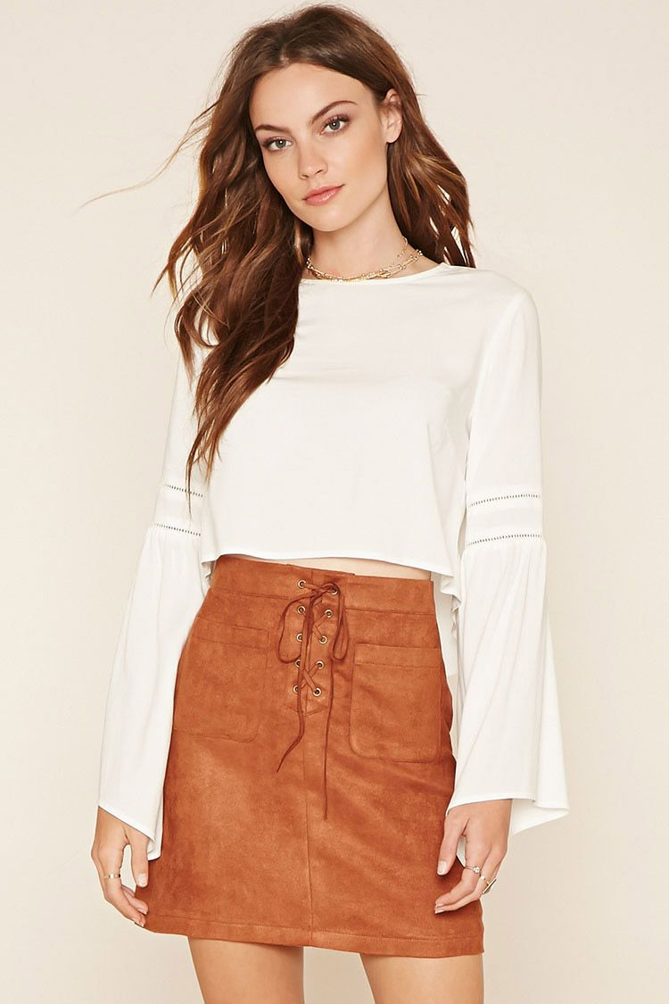 abe05195d8ac Forever 21 Contemporary - A faux suede mini skirt featuring two front  pockets, a self-tie lace-up fly, and a concealed back zipper.