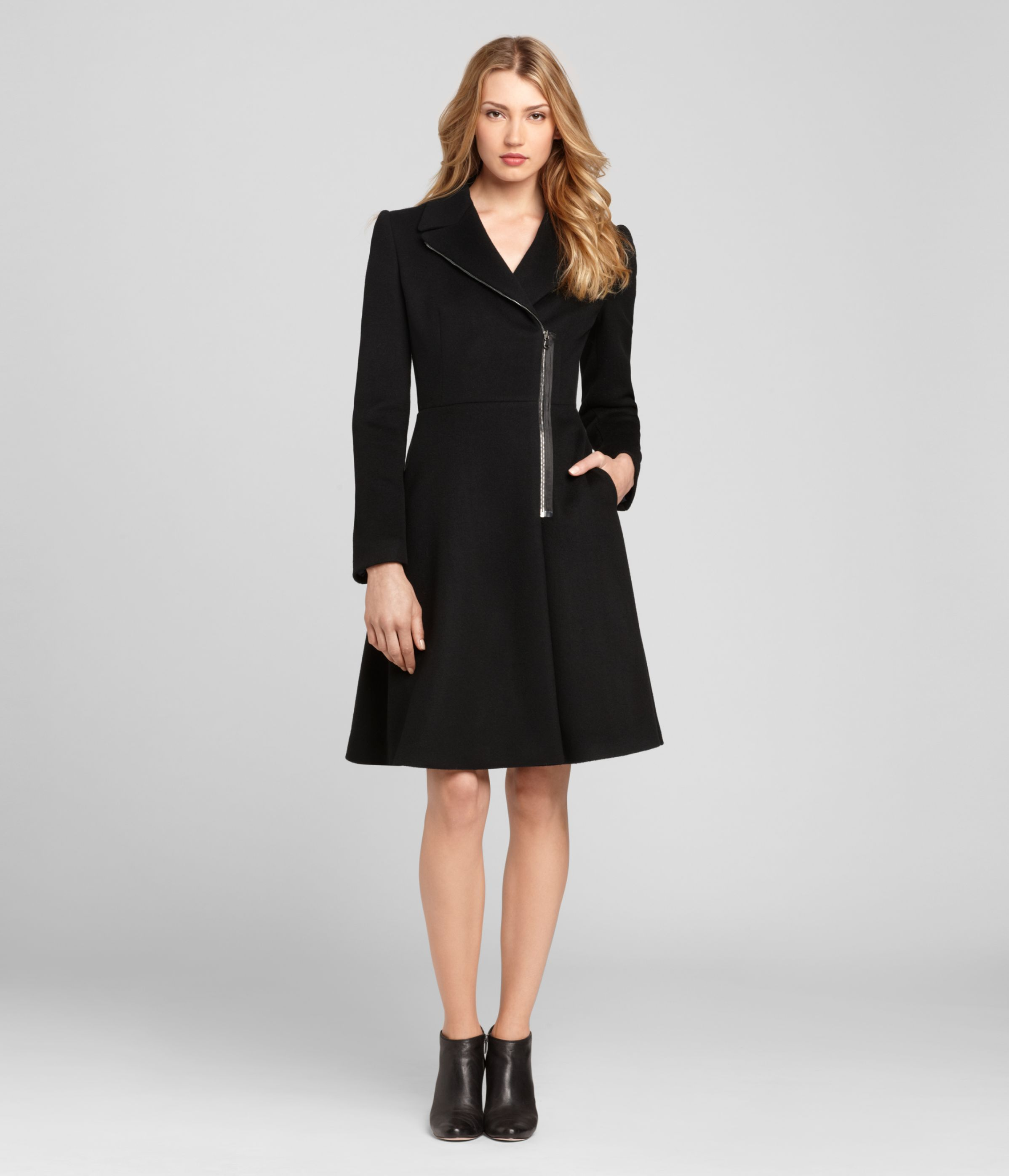 I don't know which I love more: the ladylike shape, the ever-so-slightly puffed shoulders or the off-center zippered front. All that in all black will work with pretty much everything you wear from late October to mid-March: Women's 'Aliza' coat by Elie Tahari