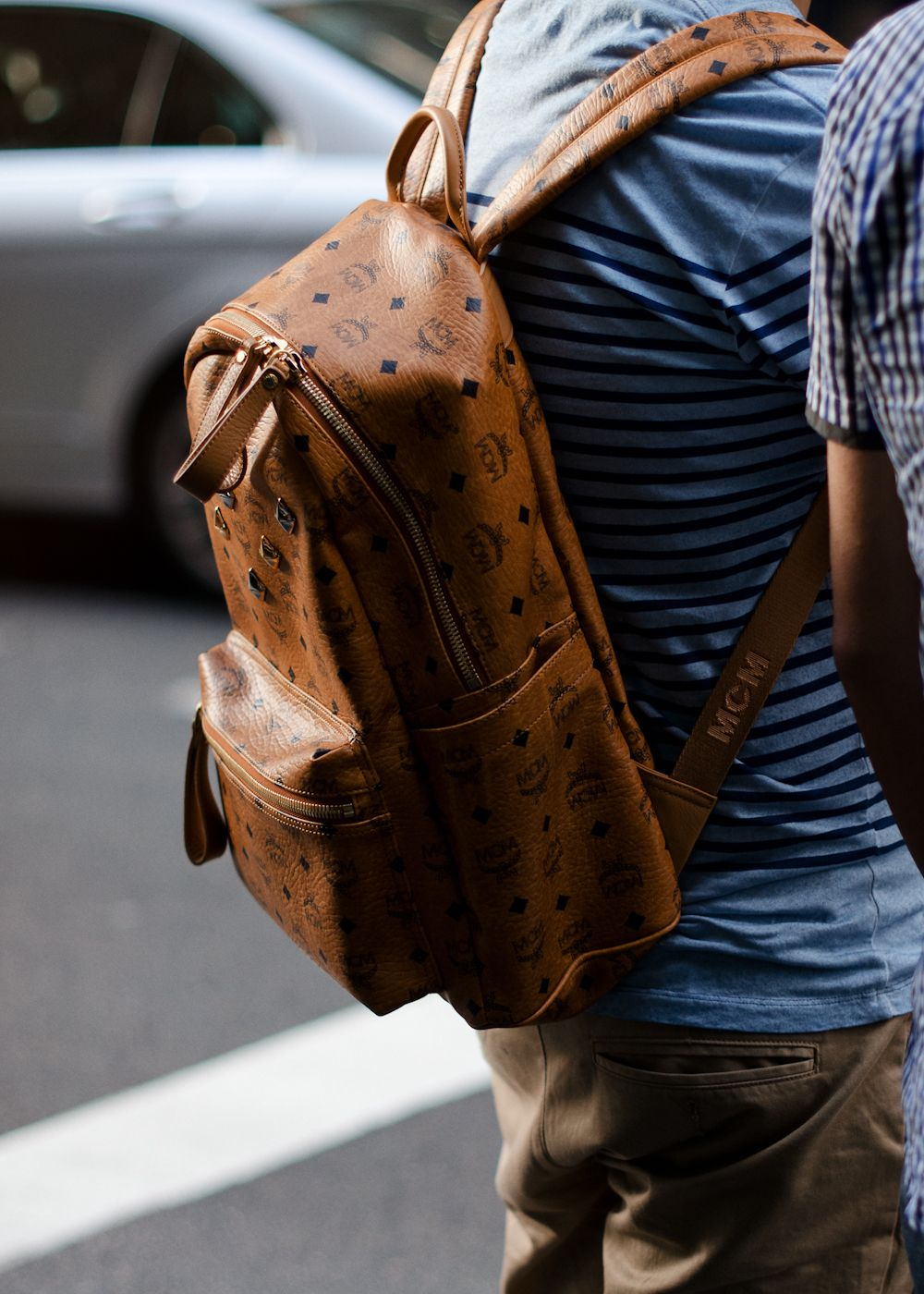 Studs and leather. Similar look: MCM Backpack Heritage and Stark ...