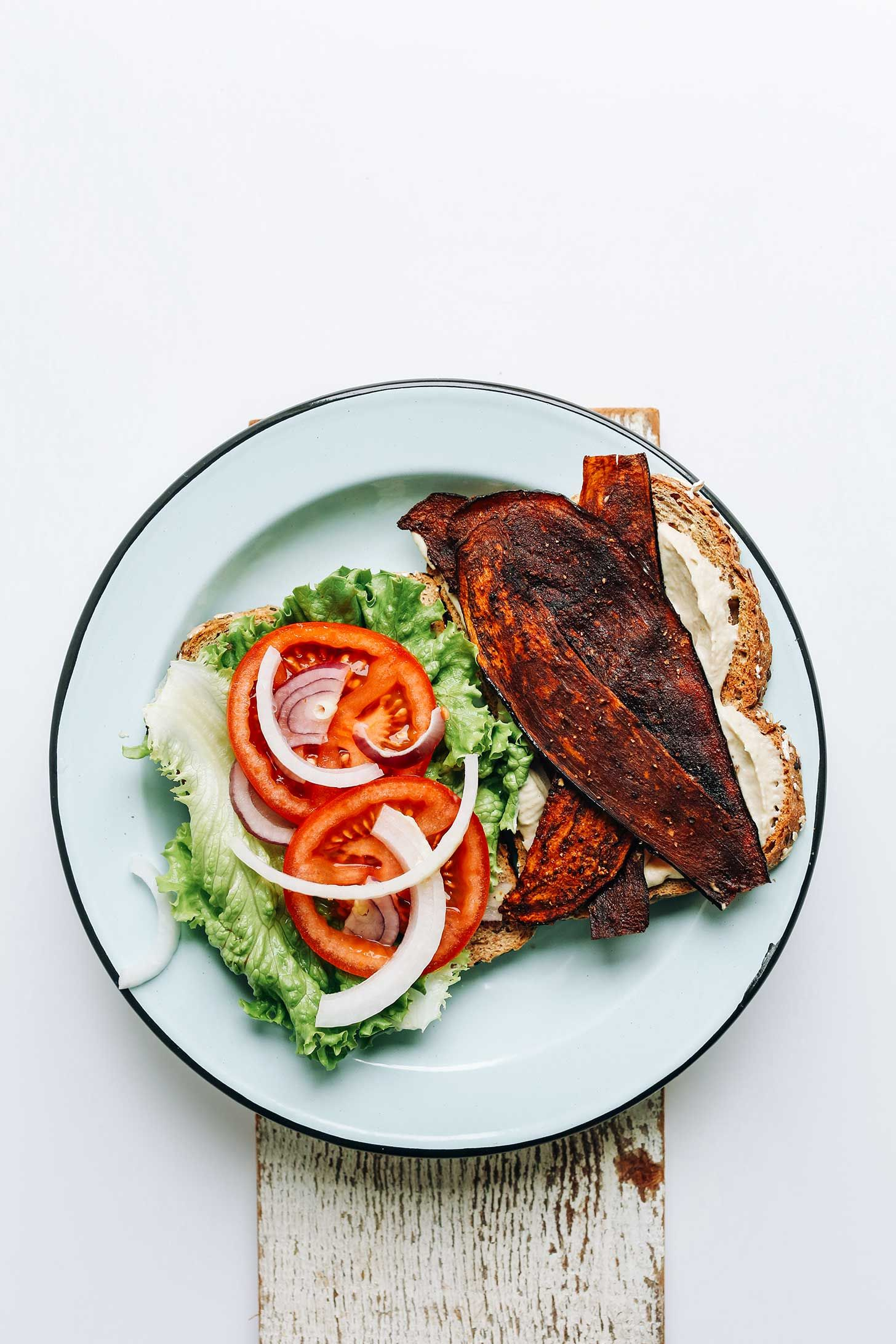 """6-Ingredient vegan """"BLT"""" sandwich made with vegan mayo and eggplant bacon! Crisp, smoky, flavorful, and so delicious."""