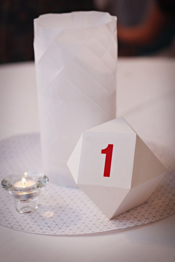 Table numbers bold color on stark white origami