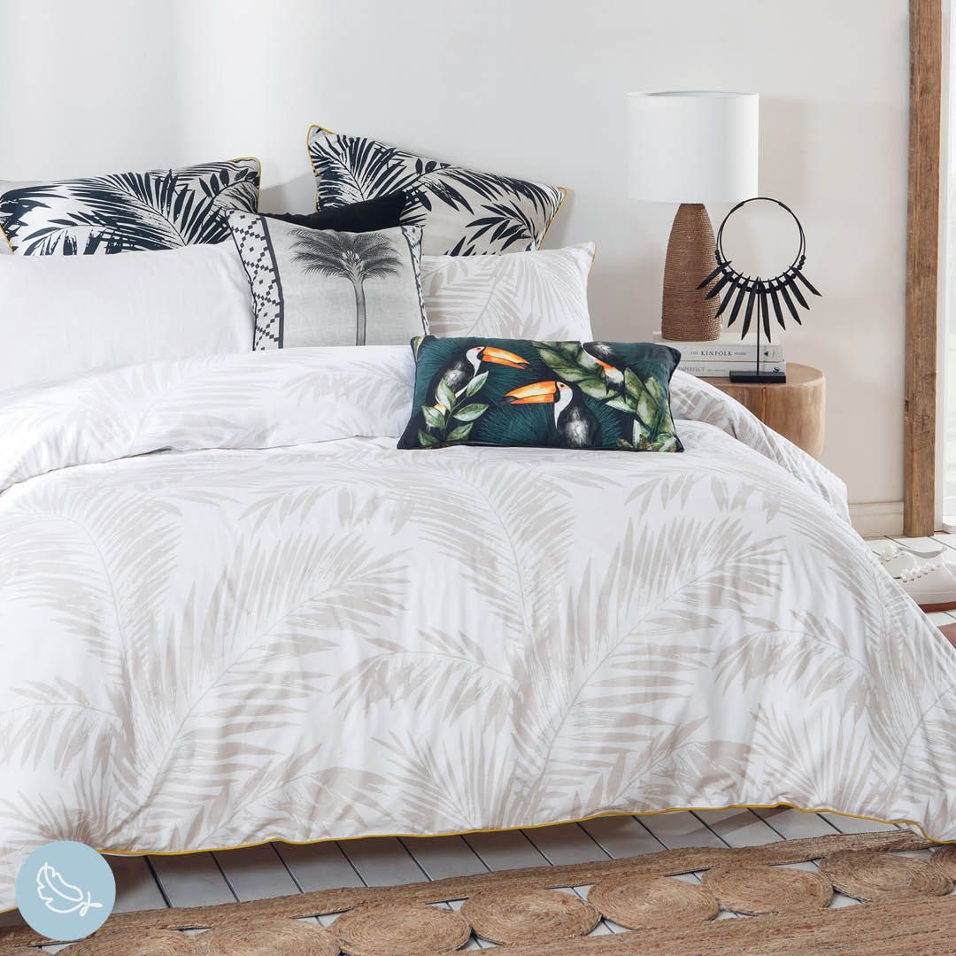 Add subtle palm patterns to your bed to create a gorgeous, summery feel! #PillowTalkAustralia #ForTheLoveOfComfort #bedroomdecor #bedroomstyling #quiltcoverset #quilt #bedroom