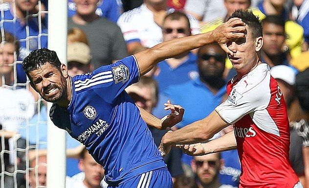 Diego Costa appears to be slapping Laurent Koscielny with his ...