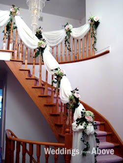 my reception venue features a huge staircasepossibility decoration idea?