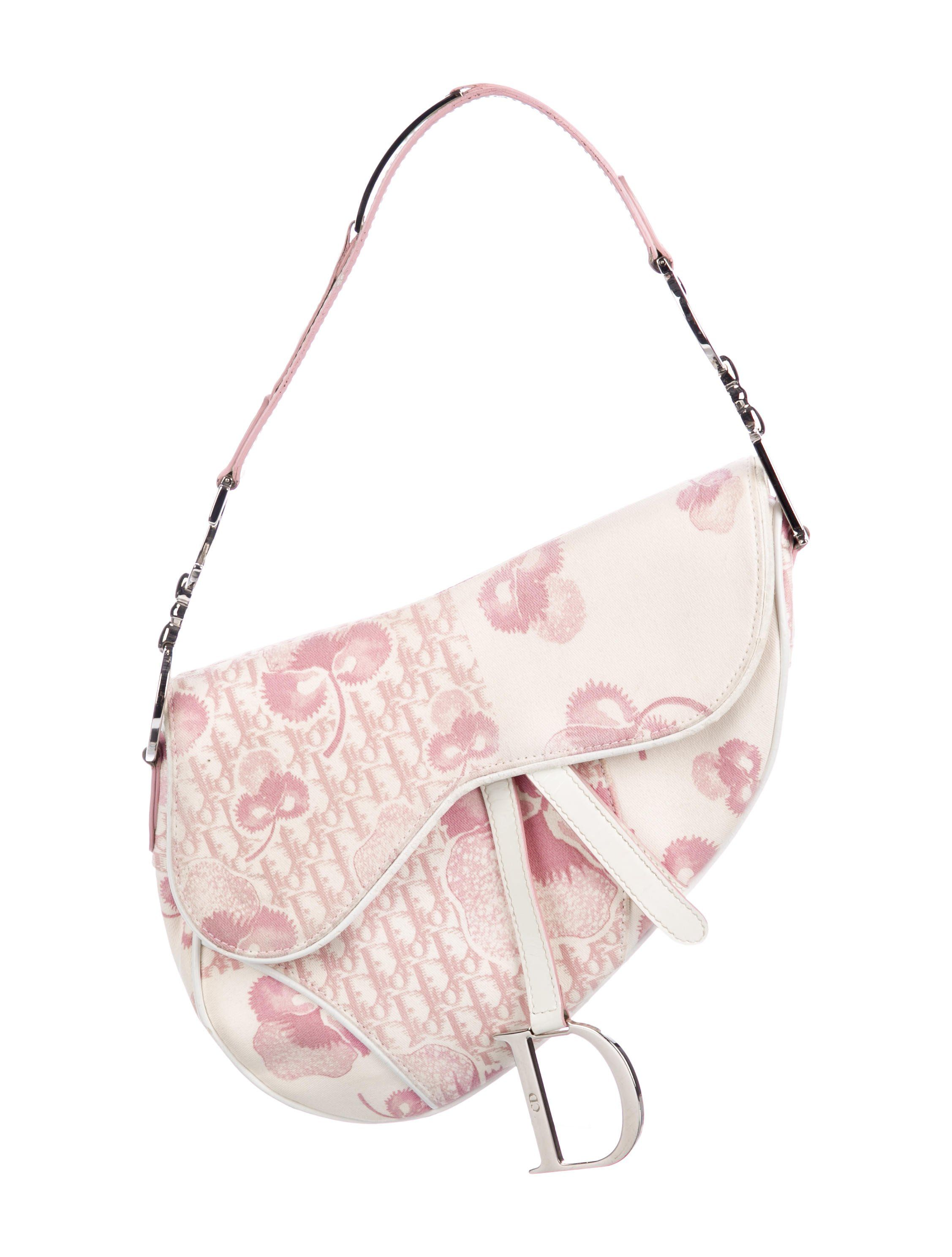 0ea3d120e7d Pink and creme floral Diorissimo coated canvas Christian Dior Girly saddle  bag with silver-tone hardware, single flat shoulder strap featuring logo ...