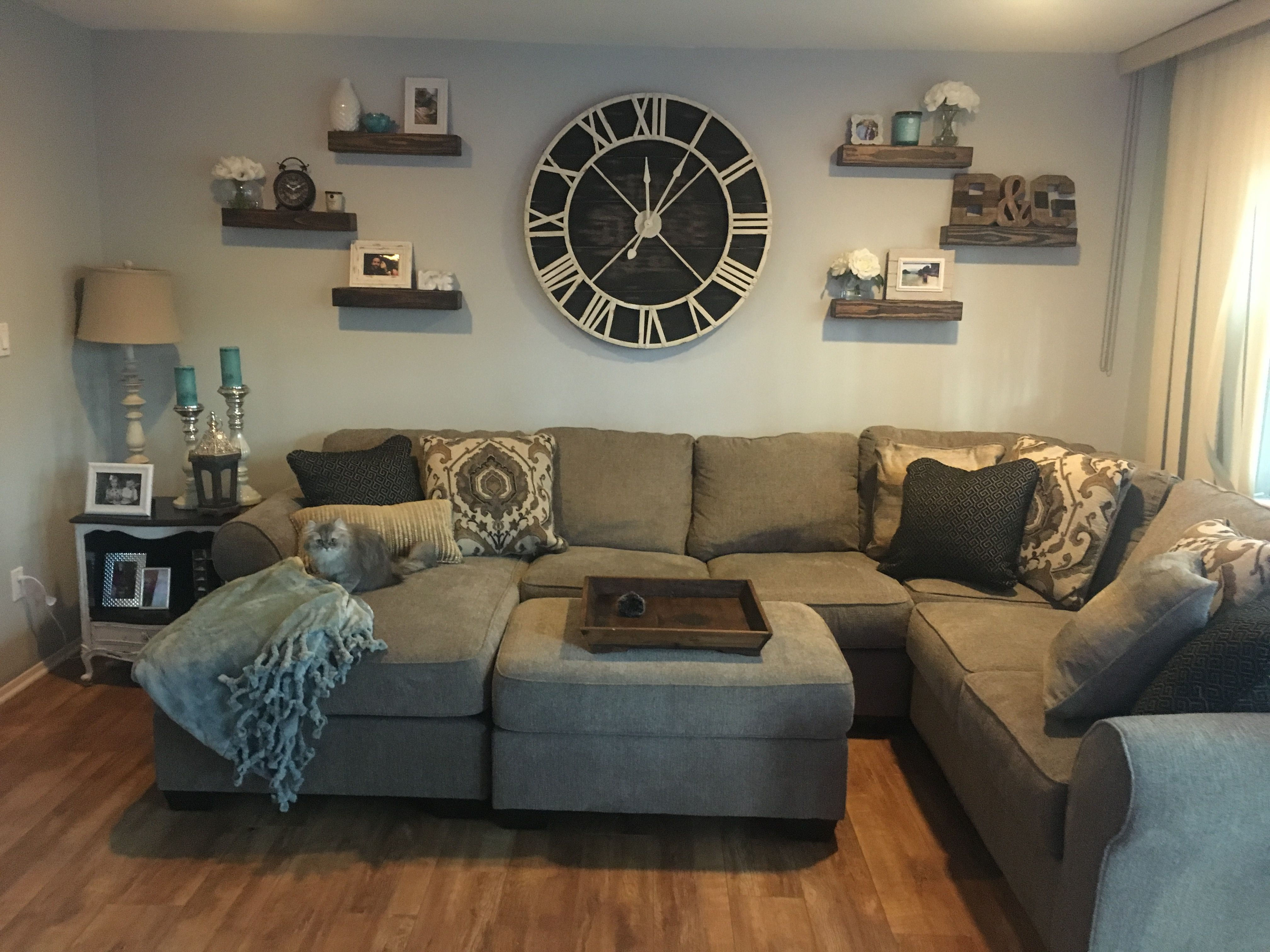Living Room Wall Clocks Looks Oversized Clock With Floating Shelves Indiana Home