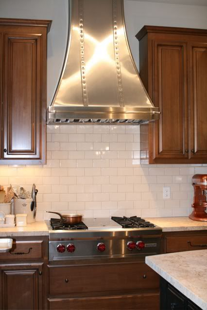 Kitchen Range Hoods · Modern Aire Hood With Tile In Background