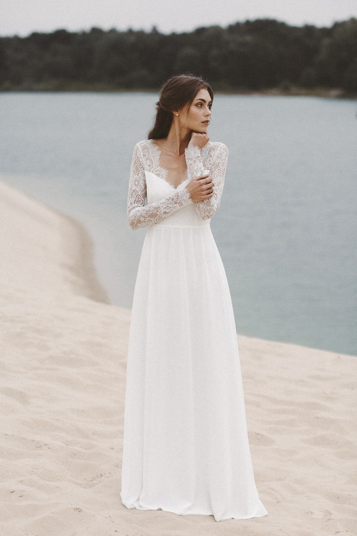 Wedding Dress With Long Lace Sleeves And Low Neckline Light Lace Bohemian Wedding Dress Long Sleeve Wedding Dresses Vintage Bohemian Bohemian Wedding Dresses [ 1104 x 736 Pixel ]