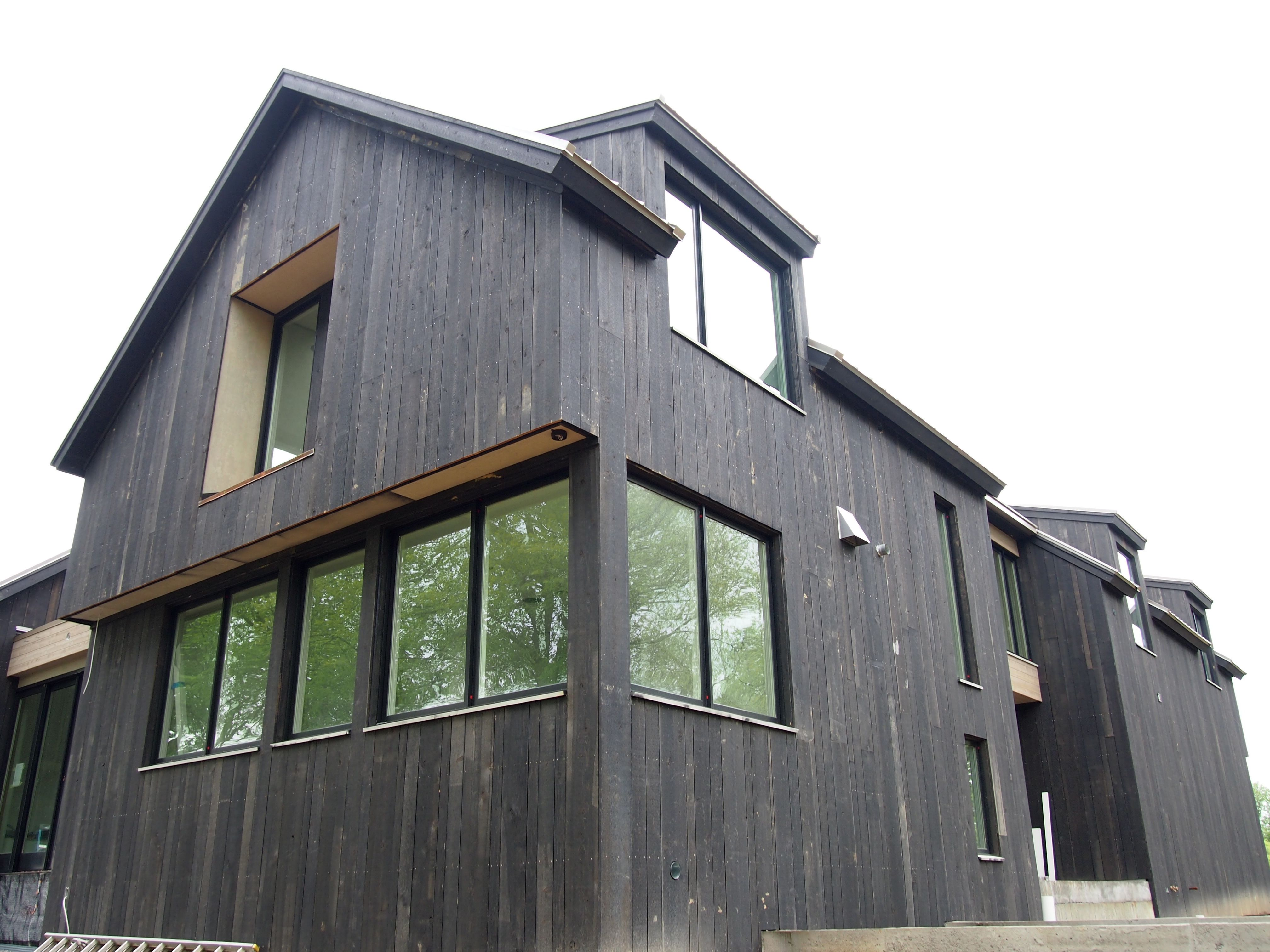 Black vertical cedar siding and black clad windows my for Vertical siding on house