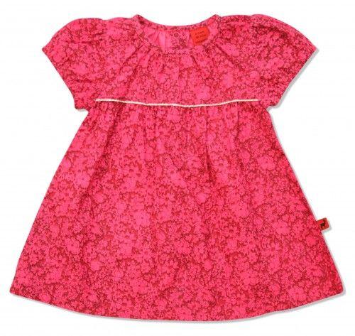 Deze is leuk voor de feestdagen en bijzonder gelegenheden! Warm roze/rood jurkje voor kleine meisjes, met glitterdetail op de voorzijde. Uitlopend model, van het Deense merk HJORTH