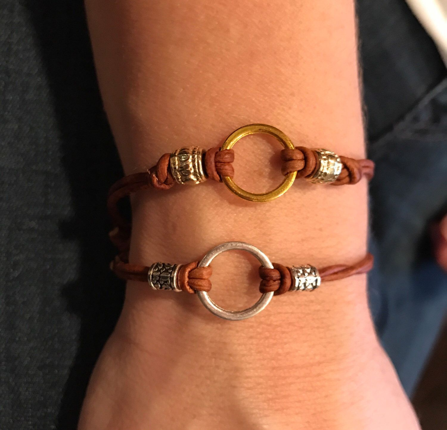 Adjustable leather bracelet with silver or gold circle by AdornedBySuzie on Etsy https://www.etsy.com/listing/499124505/adjustable-leather-bracelet-with-silver