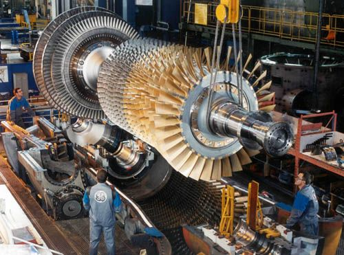 The Assembly Of The Massive Ge 9e Heavy Duty Gas Turbine Which Is Used For Utility And Industrial Power Generation Gas Turbine Turbine Engine Steam Turbine