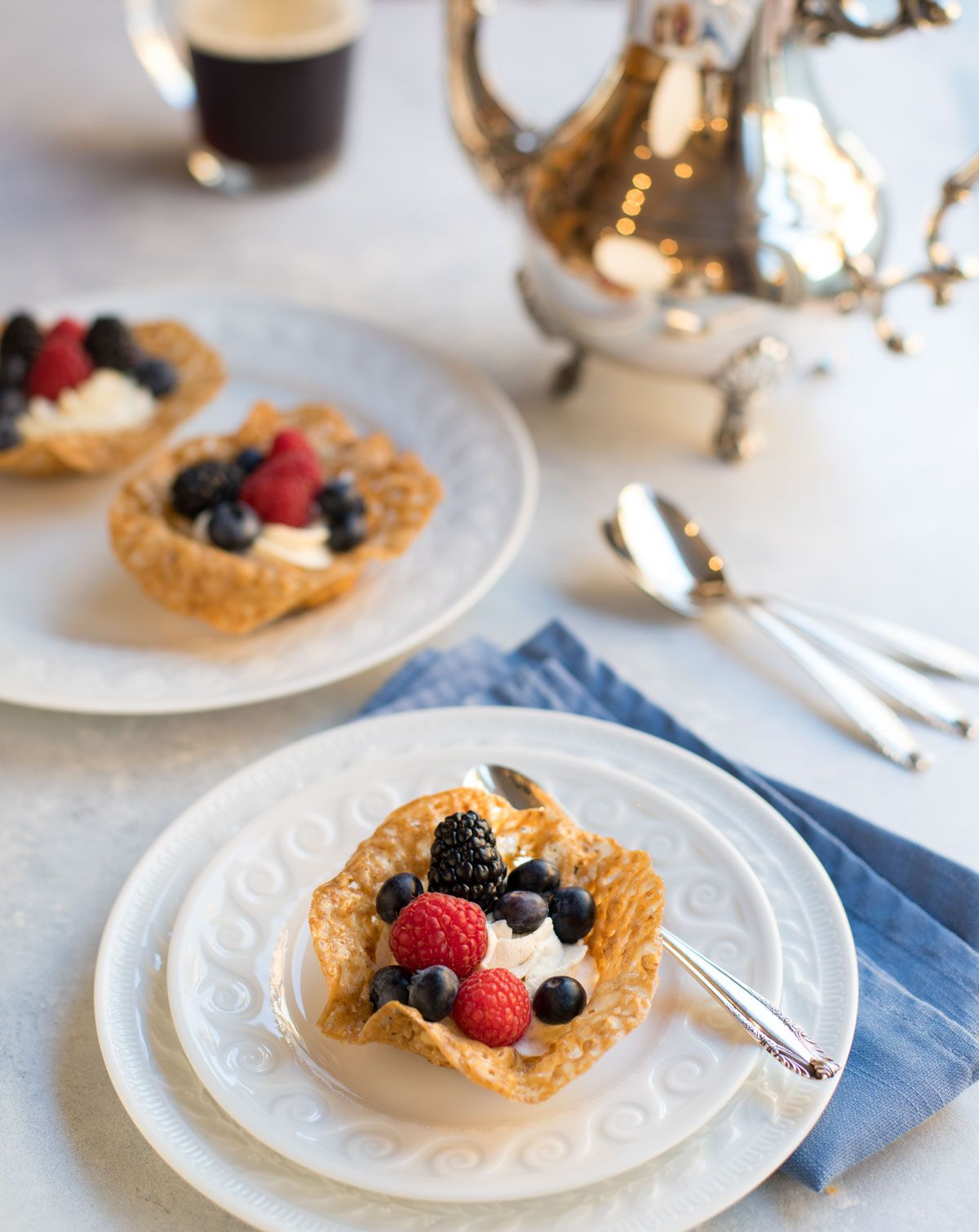 Pecan Cookie Cups with White Chocolate-Rum Mousse Delicate and elegant Pecan Cookie Cups are filled with scrumptious White Chocolate-Rum Mousse and topped with fresh berries - the perfect light and flavorful dish to end a spring or summer meal!
