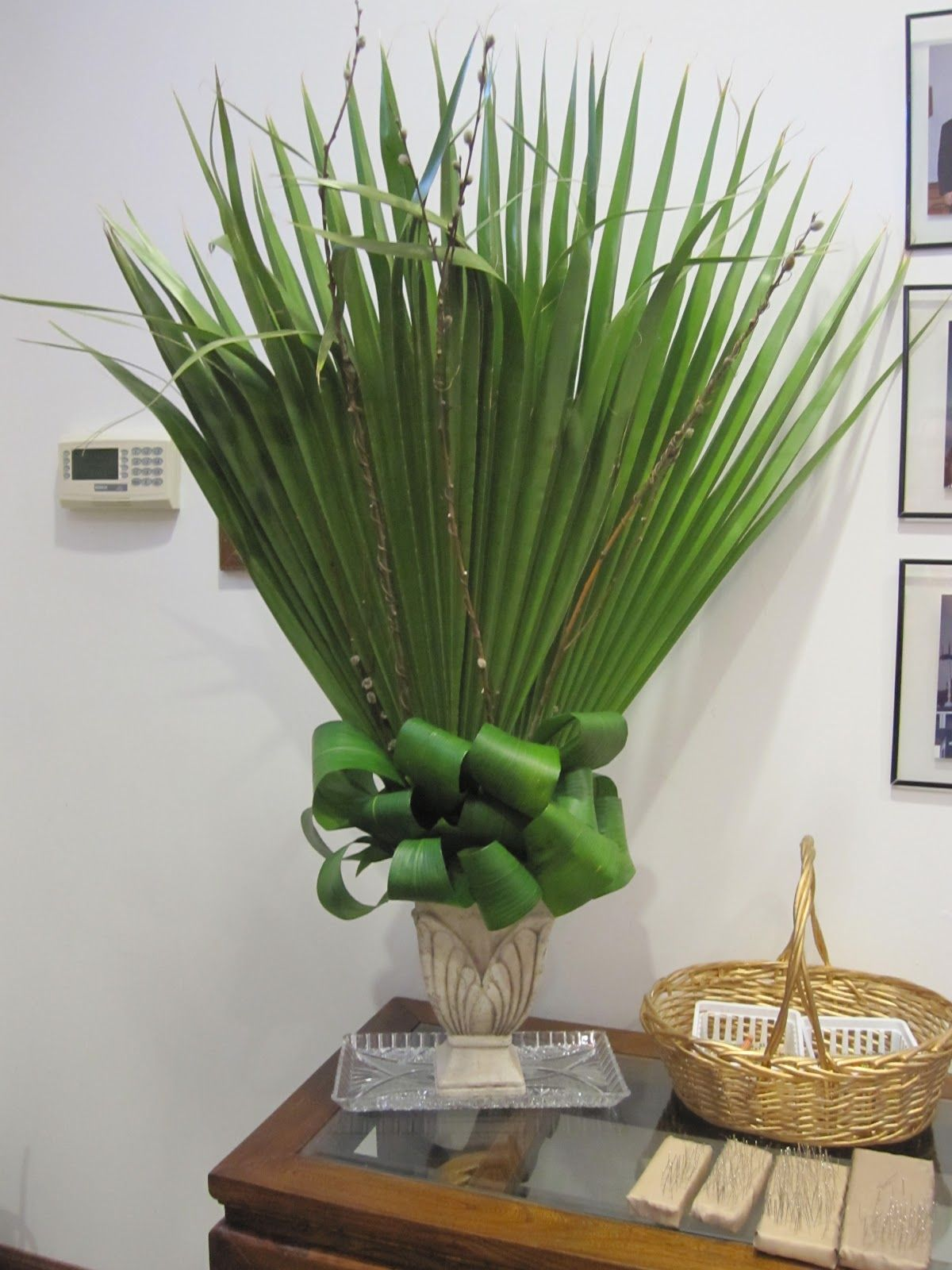 Palm Sunday.....I love this arrangement. Ti leaves with the palm ...