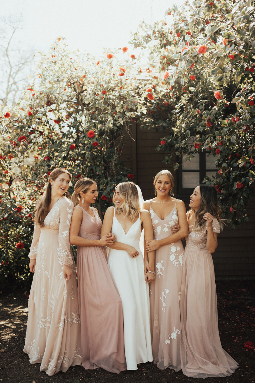 Bridesmaids In Blush Bhldninnapa From Left To Right Belize Dress Kia Dress Wedding Bridesmaid Dresses Mismatched Bridesmaid Dresses Wedding Bridesmaids